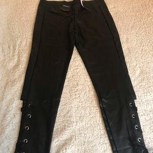 A pair of faux leather pants
